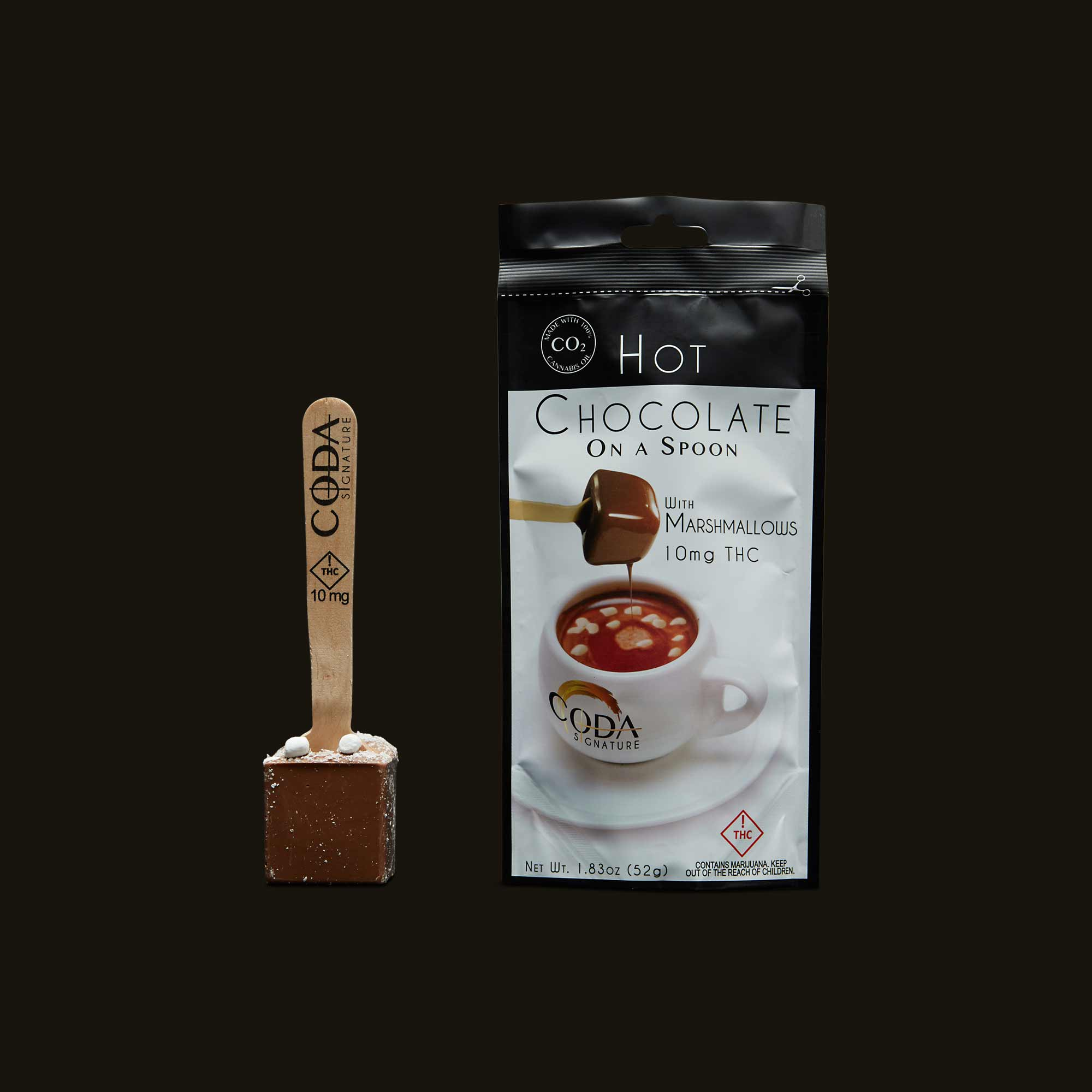 Coda Signature Milk Chocolate With Marshmallows On A Spoon